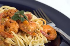 Pasta and shrimp dinner. Close up of shrimp and pasta dinner royalty free stock image