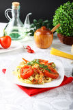 Pasta with shrimp, fresh tomatoes and parsley Stock Photos