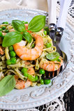 Pasta with shrimp and peas Stock Photo