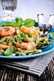 Pasta with shrimp and peas Stock Photos