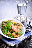 Pasta with shrimp and peas Stock Image