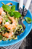Pasta with shrimp and peas Stock Photography