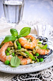 Pasta with shrimp and peas Stock Images