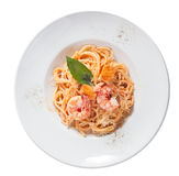 Pasta with shrimp, salmon, a plate, top, tomato paste Royalty Free Stock Photography