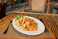 Pasta with shrimp and tomato Stock Images