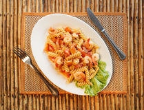 Pasta with shrimp and tomato Stock Image