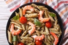Pasta with shrimp, tomato and pesto sauce close-up. horizontal t Royalty Free Stock Photo