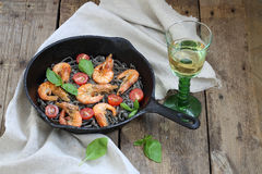 Pasta with shrimp , tomatoes, Basil and white wine. White wine and pasta with shrimp, Basil and cherry tomatoes Royalty Free Stock Photos