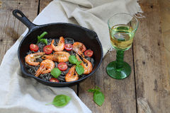 Pasta with shrimp , tomatoes, Basil and white wine. White wine and pasta with shrimp, Basil and cherry tomatoes Royalty Free Stock Photo