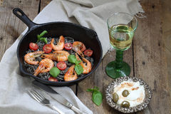 Pasta with shrimp , tomatoes, Basil and white wine. White wine and pasta with shrimp, Basil and cherry tomatoes Royalty Free Stock Photography