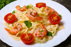 Pasta with shrimp, tomatoes, herbs and cream sauce. Royalty Free Stock Photography