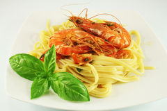 Pasta with shrimps. And basil Stock Photography