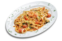Pasta with shrimps. Pasta with seafoods and cherry tomato.  White isolated with path Stock Photos