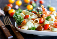 Pasta with shrimps and cherry tomatoes Stock Photo