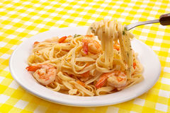 Pasta with shrimps on fork Stock Images