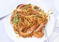 Pasta with shrimps at a greek tavern Stock Images