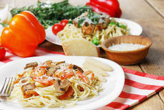 Pasta with shrimps and mashrooms Stock Images