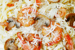 Pasta with shrimps and mashrooms on the wooden table Royalty Free Stock Images