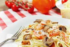 Pasta with shrimps and mashrooms on the wooden table Stock Photo
