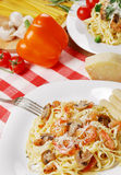 Pasta with shrimps and mashrooms on the wooden table Stock Images