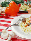 Pasta with shrimps and mashrooms on the wooden table Stock Image