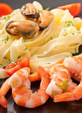 Pasta with shrimps, mussels Stock Photo
