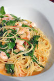 Pasta with shrimps and rucola. A plate of delicious italian pasta: spaghetti with shrimps and rucola royalty free stock photography
