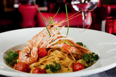 Pasta with shrimps and tomato Stock Images