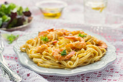 Pasta with shrimps and tomato sauce Stock Photography