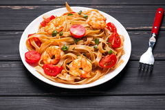Pasta with shrimps and tomatoes Stock Images
