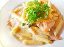 Pasta with smoked salmon Stock Photos