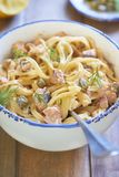 Pasta with smoked salmon and capers in cream sauce Royalty Free Stock Image