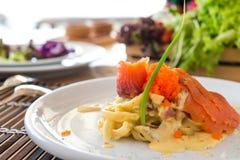 Pasta Smoked Salmon & Ebiko with creamy white sauce royalty free stock photography