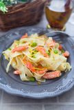Pasta with smoked salmon and lemon zest Stock Images