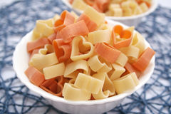 Pasta. Some colourful heart pasta in a bowl Royalty Free Stock Photography