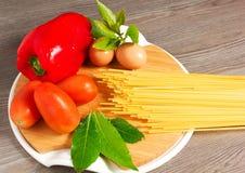 Pasta spaghetti. Pasta and spaghetti on a wood table Stock Photos