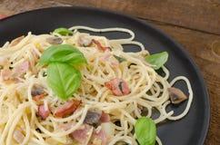 Pasta - spaghetti, basil, ham and leek Stock Photos