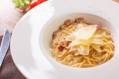Pasta spaghetti carbonara on white background. Top view Stock Images