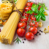 Pasta spaghetti, cherry tomatoes and spices Royalty Free Stock Photography