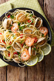 Pasta spaghetti with clam, shrimp, chili and lime close-up. Vert Stock Photography