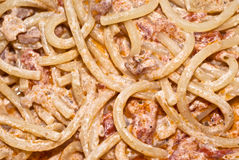 Pasta- Spaghetti with cream and bacon. Pasta -Spaghetti and tomato sauce whit bacon and cream,close up stock photography