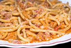 Pasta- Spaghetti with cream and bacon. Pasta -Spaghetti and tomato sauce whit bacon and cream,close up royalty free stock images