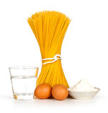 Pasta (spaghetti) eggs and water glass Royalty Free Stock Images