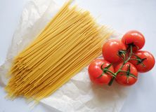 Pasta spaghetti with fresh vegetables red tomatoes Royalty Free Stock Images