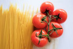 Pasta spaghetti with fresh vegetables red tomatoes Royalty Free Stock Image