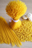 Pasta, spaghetti, and garlic on the table. Pasta, spaghetti, and garlic on the table Royalty Free Stock Photography