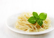 Pasta spaghetti and green basil leaf Royalty Free Stock Images