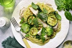 Pasta spaghetti with green vegetables and roasted chicken breast royalty free stock image