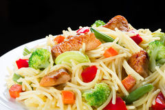 Pasta. Spaghetti with meat and vegetables. Stock Photography