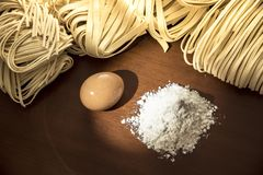 Pasta spaghetti noodles eggs and flour stock photography